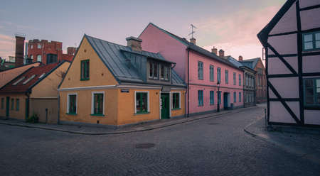 Old houses along cobblestoned streets in medieval old town of Lund Sweden during summer evening Archivio Fotografico