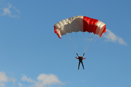 Parachute against blue sky Stock Photo