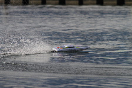 remote controlled: RC remote controlled power boat racing on a lake