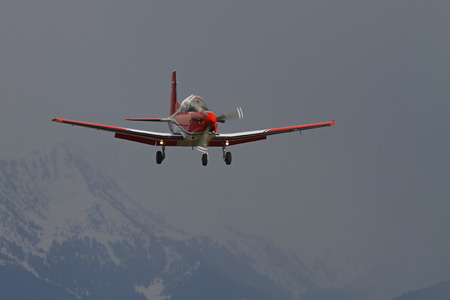 icey: Airplane approaching the runway in mountainous terrain in the winter Stock Photo