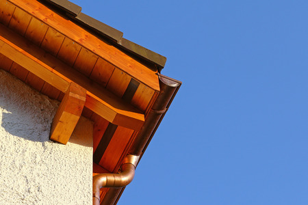 ceramic tiles: New roof top detail with ceramic tiles and copper water gutter Stock Photo
