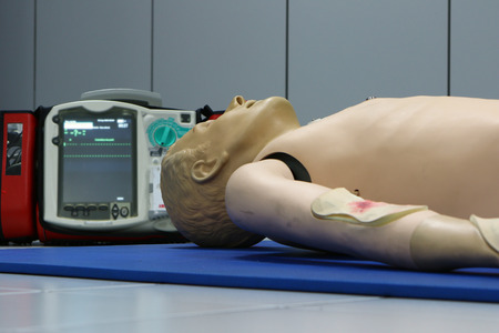 defibrillator: Defibrillator and CPR dummy doll