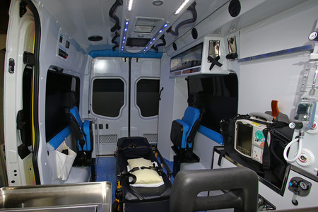 emt: Interior of a modern ambulance with stretcher Stock Photo