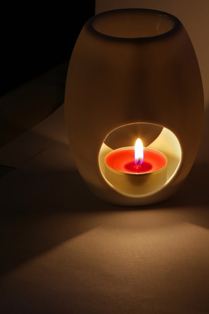 scented: Scented candle in soft low light with room for text Stock Photo
