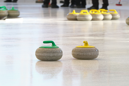 curling: Curling stones standing still on the ice during a game