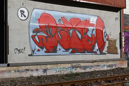 urban decline: Cadenazzo, Switzerland, February 2016, Urban wall texture along railroad tracks keep popping up along railway tracks - graffiti art abstract background