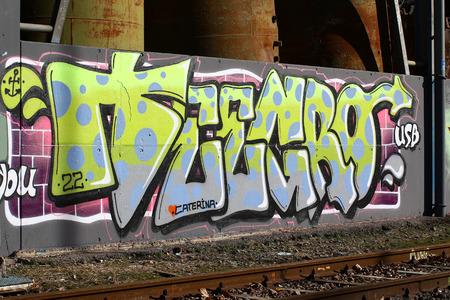 railroad tracks: Cadenazzo, Switzerland, February 2016, Urban wall texture along railroad tracks keep popping up along railway tracks - graffiti art abstract background