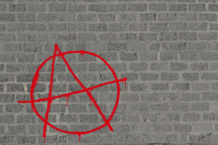 anarchy: Concrete block wall with anarchy in red sprayed on it in red, illustration