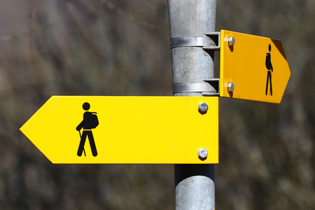 metal pole: Blank yellow direction signs on metal pole for pedestrian trails Stock Photo