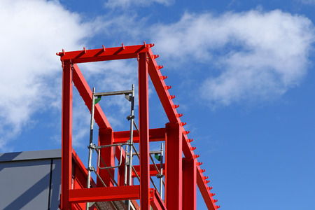 steel beam: New steel beam construction being built against blue skies and white clouds Stock Photo