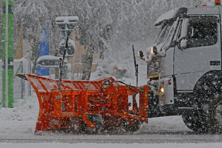 snow plow: Detail of snow plow truck and blade in action during a heavy snow storm