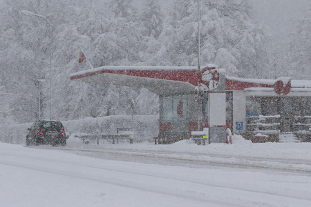 driving conditions: Monte Ceneri, Ticino,mountain pass during a heavy winter snowstorm
