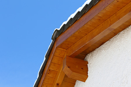 ceramic tiles: New roof top detail with ceramic tiles with snow against blue skies