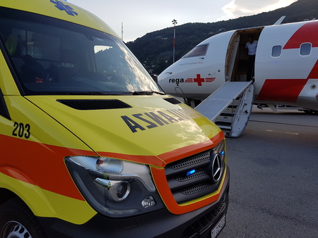 just arrived: Lugano, TicinoSwitzerland - May 26, 2016: REGA Canadair 640 air ambulance just arrived from Sardegna at Lugano airport for an emergency patient transfer Editorial