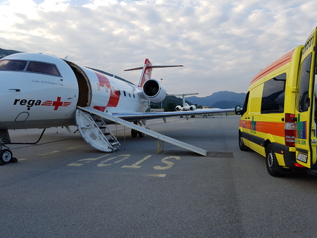 Lugano, TicinoSwitzerland - May 26, 2016: REGA Canadair 640 air ambulance just arrived from Sardegna at Lugano airport for an emergency patient transfer Editorial