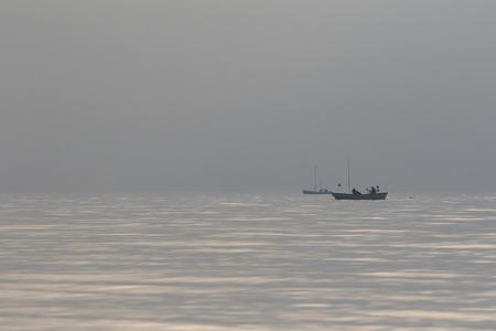 haze: Fishing boats in haze