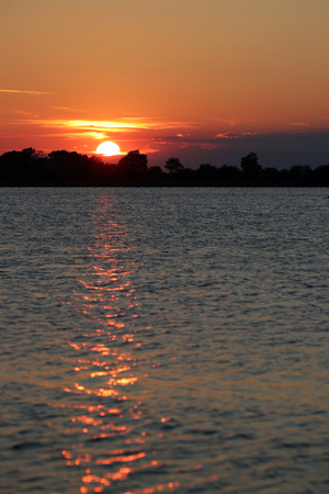 Colorful sunset over the Adriatic laguna between Grado and Venice