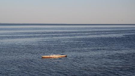 Flat bottom fishing boat anchored in the venetian adriatic sea background