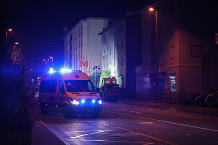 Lugano, Switzerland, November 23, 2017: Croce Verde ambulance in the streets of Lugano responding to an emergency call