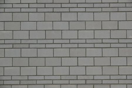 Gray concrete brick wall background