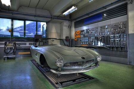 1950s classic roadster being rebuilt in garage HDR Stock Photo