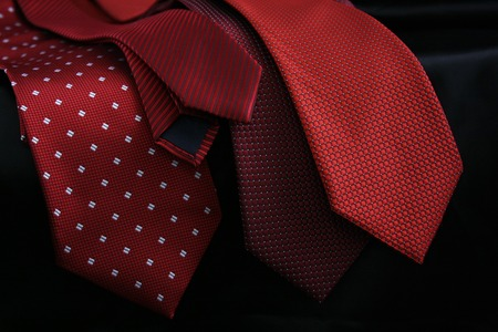 neck tie: White dress shirt with red tie detailed closeup.