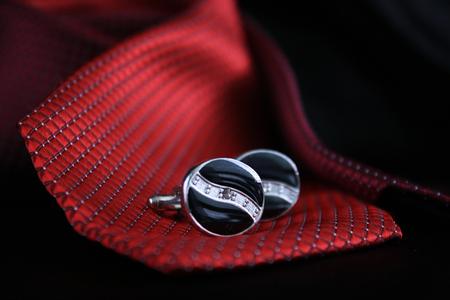 dressy: Set of tie and cufflinks with dress shirt and black background