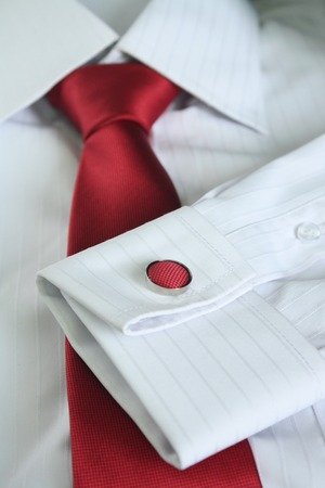 red tie: White dress shirt with red tie detailed closeup.