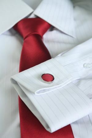 dress shirt: White dress shirt with red tie detailed closeup.