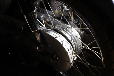spokes: Spokes motorcycle wheel with brake system, under the sun