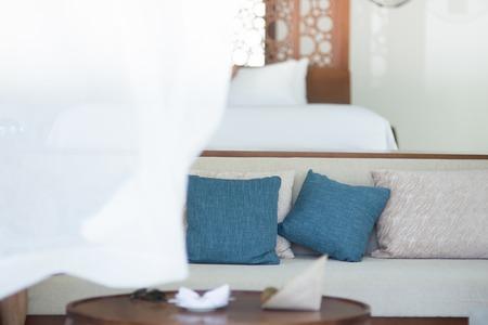 white sofa: white sofa with two blue pillows  isolated on white background