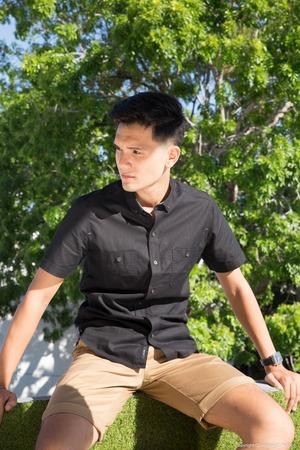 cute boys: Portrait of young beautiful fashionable man against autumn garden.. Stock Photo