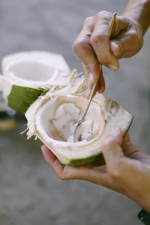 the topical: Topical coconuts. with hand chopping and eating . Stock Photo