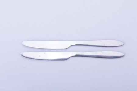 cook out: spoon and knife on white background is isolated