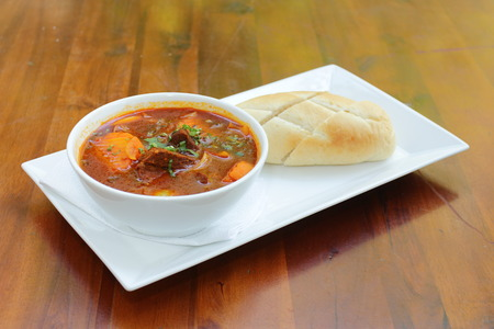 Vietnamese-Style Beef Stew Bo Kho , with bread Stock Photo