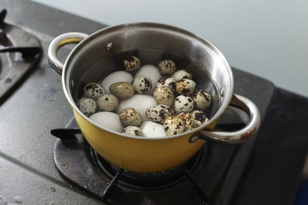 duck egg: close up duck egg and quail eggs in the pot