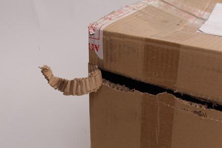 Fragile box damaged isolated on white. Фото со стока