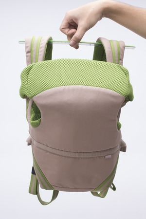 A cute baby carrier a comfortable tool for mother