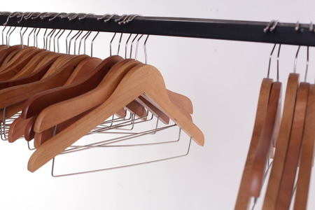 wooden clothes hangers isolated on white.