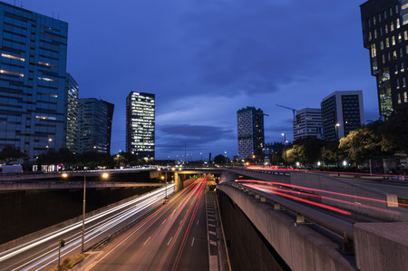 Circulation in the city at nightfall, blue hour, Barcelona Spain