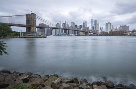 Brooklyn bridge seen from Brooklyn park on cloudy day 写真素材