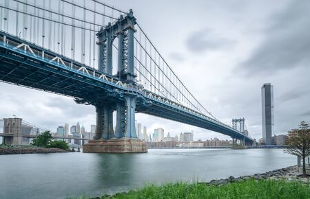 Manhattan Bridge seen from Brooklyn cloudy day 写真素材