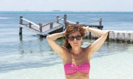 Woman with sunglasses on the Caribbean beach Banco de Imagens