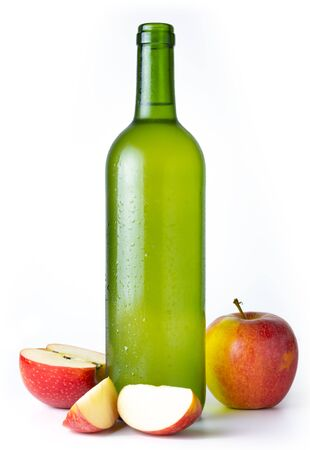 Bottle of very cold cider with apples with white background