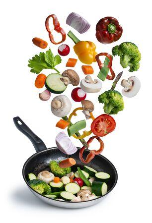 grilled fresh vegetables flying isolated on white background Banco de Imagens