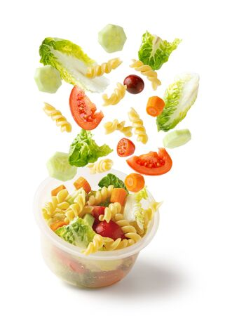 Pasta salad flying in Tupperware, for work, office, fast but healthy food, isolated from white background