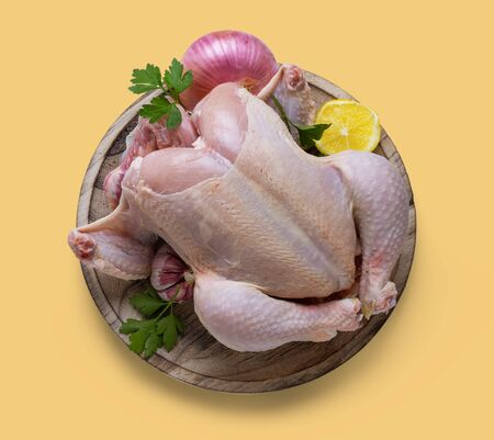 Raw chicken with broth ingredients, on isolated background, cream color Stok Fotoğraf