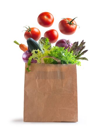 ecological bag of vegetables isolated from the background. flying vegetables Foto de archivo