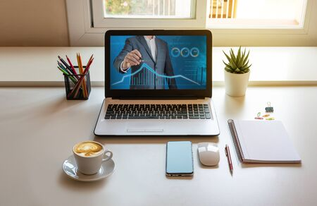 Work table at home, laptop with finance web Standard-Bild