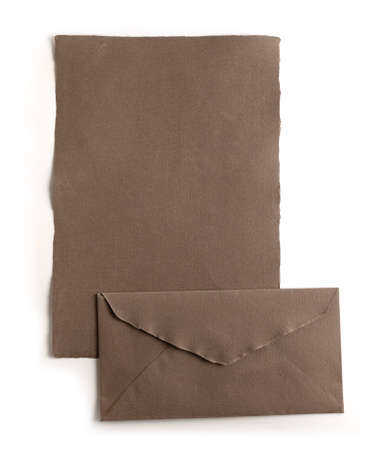 Sheet of paper and natural handmade beige envelope, isolated from the background